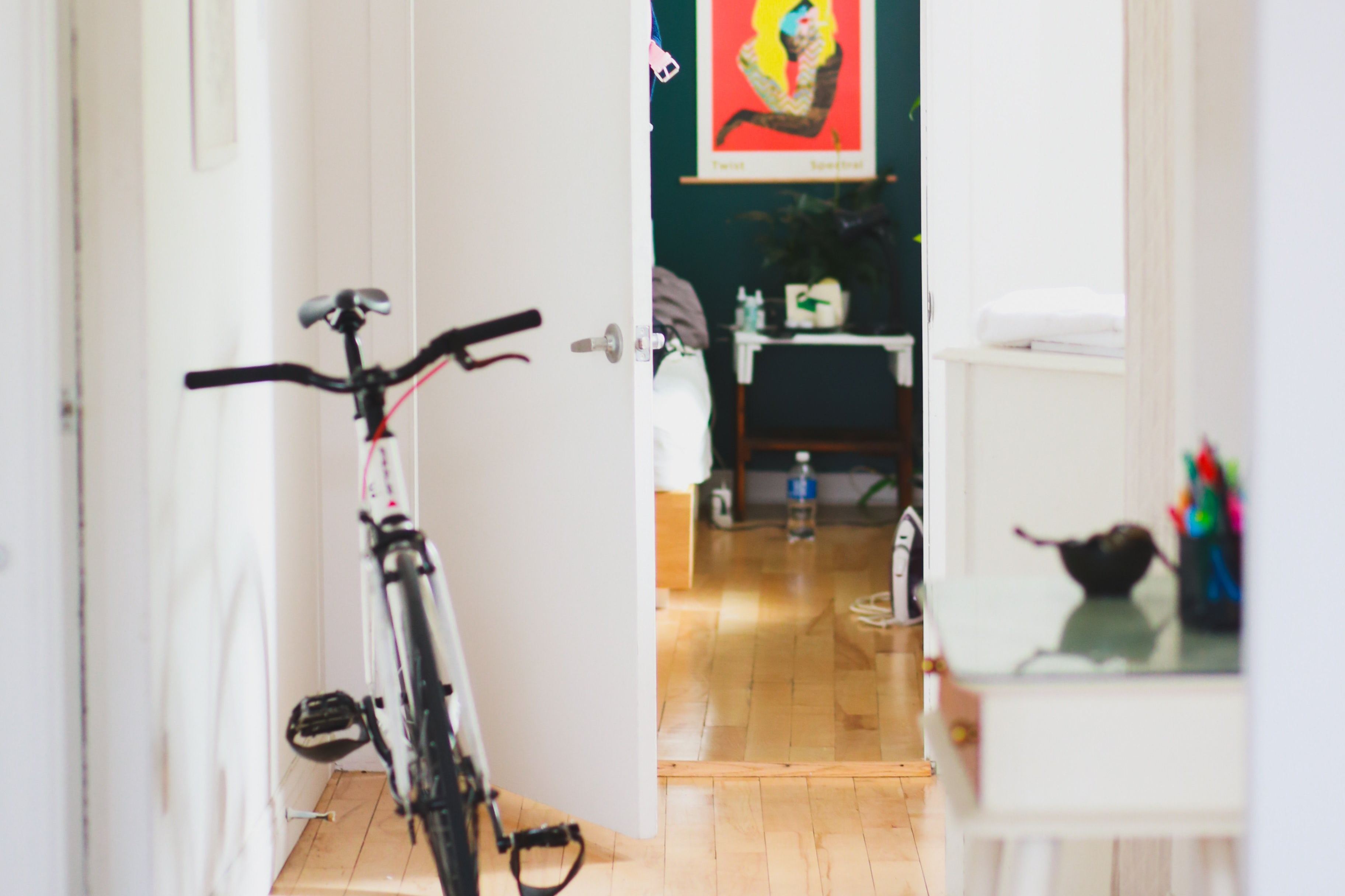interior of living space with bicycle and desk